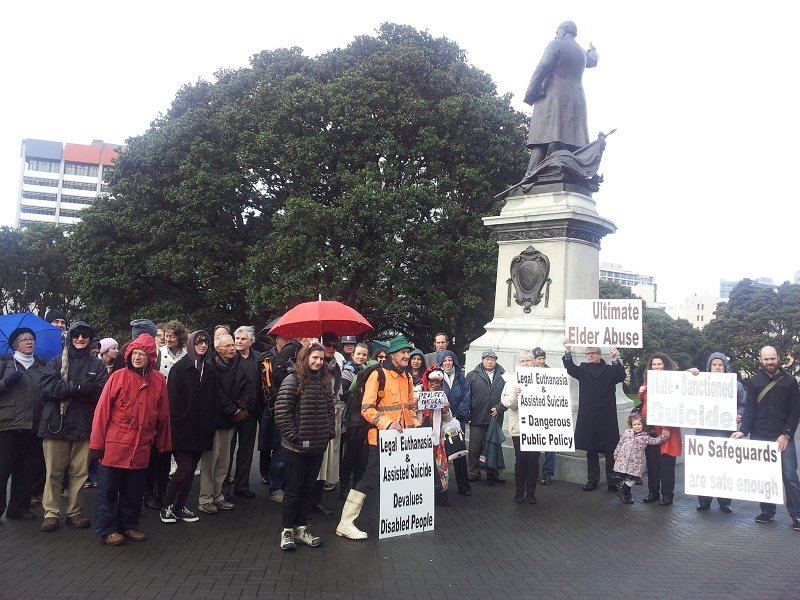 Demonstrators at statue
